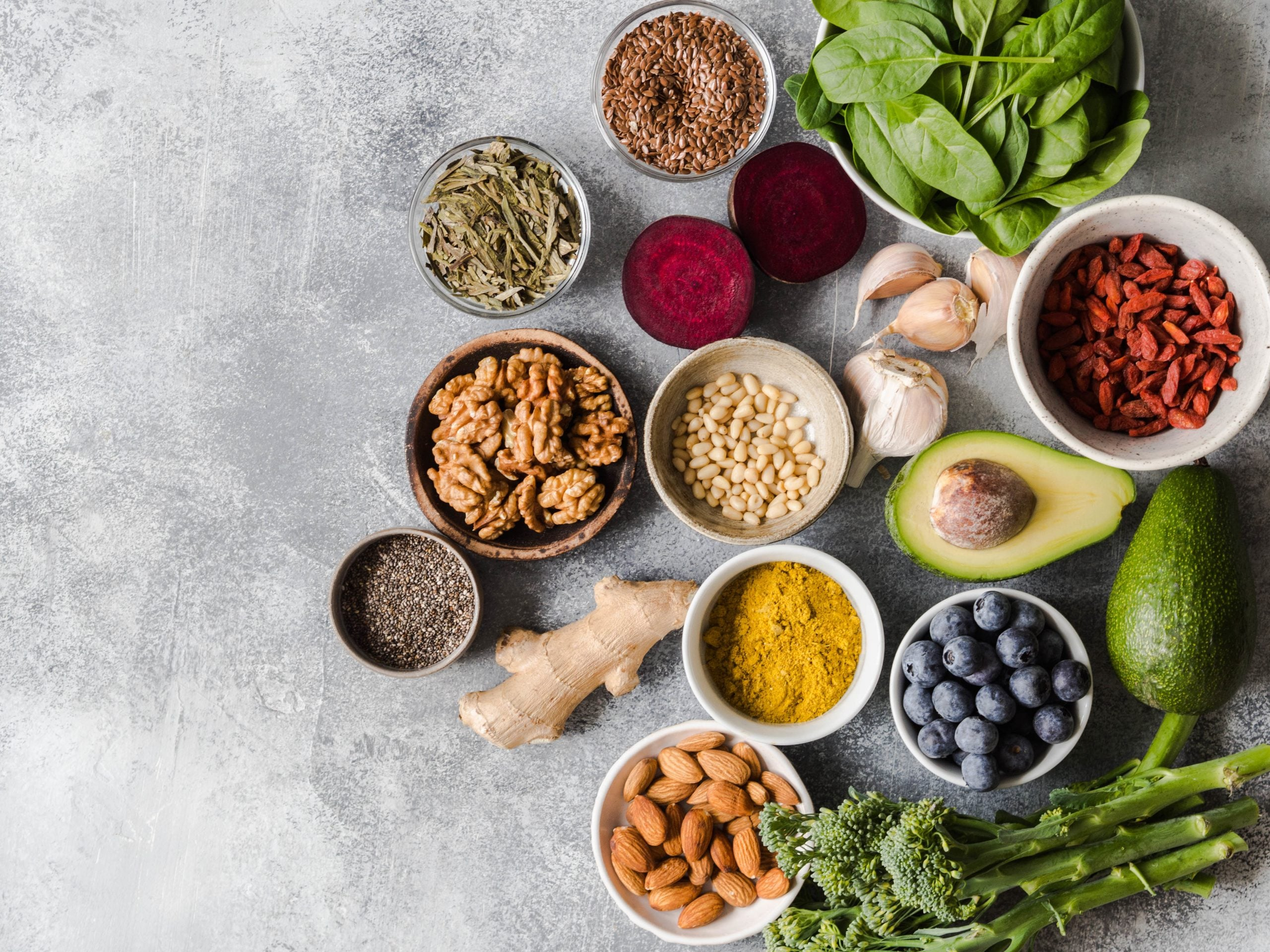 Healthy clean food - vegetables, fruits, nuts, superfoods on a gray background. Healthy eating concept.